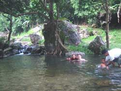 Take a refreshing dip in one of the drop pools at Sarika Waterfall